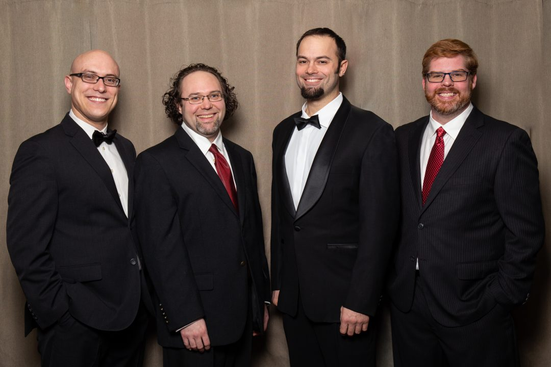 Slow No Tempo a cappella quartet from left to right Simon Walter, Ryan Noakes, Graham Speech, and Alexander Bell